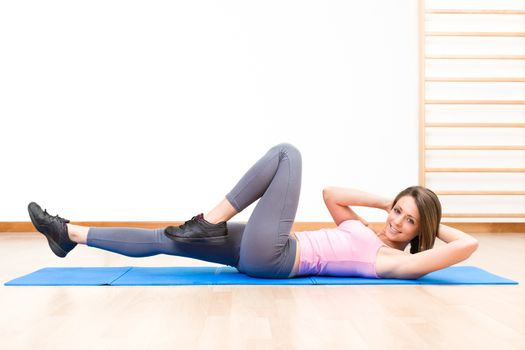 young healthy woman in abs exercises