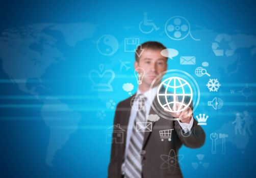 Businessman in suit pointing her finger at cloud icons. World map as backdrop