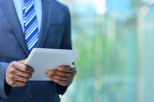 Cropped image of businesman with digital tablet