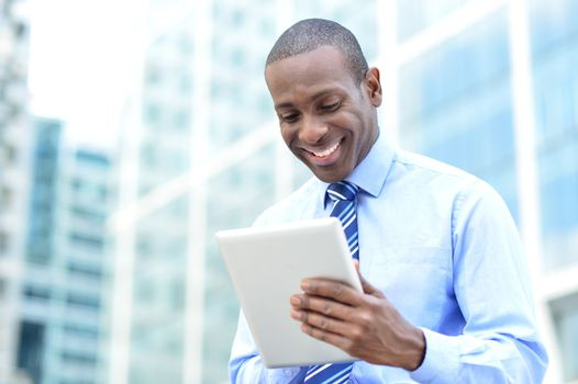 Business professional using a tablet pc