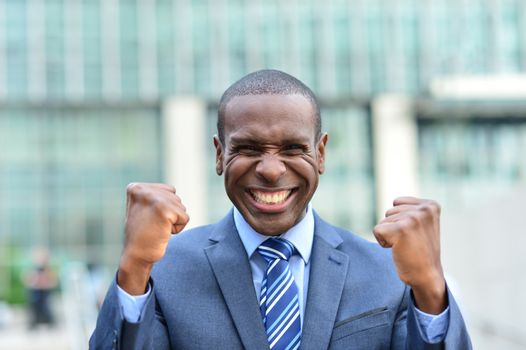 Successful businessman celebrating at outdoors