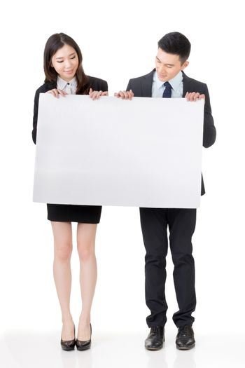 Business man and woman holding blank white board