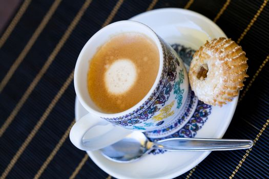 Cup of freshly brewed tea and a cookie