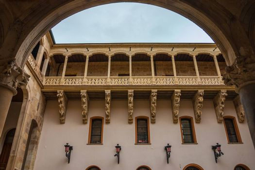 Full view of stone carved balcony in the courtyard of Salina Palace located in Salamanca