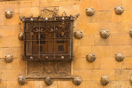 Detail of window with old forge in The House of Shells located in Salamanca Spain