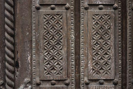 Delicate wooden carving in a old door