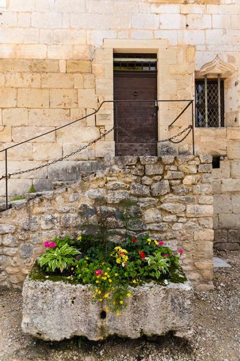 Beautiful colourful composed flower box with stairs at the bottom In Perigueux  in the french region of Dordogne