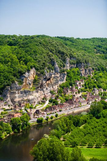 Lanscape view of the village of La Roque Gageac in France with the dordogne river at the bottom