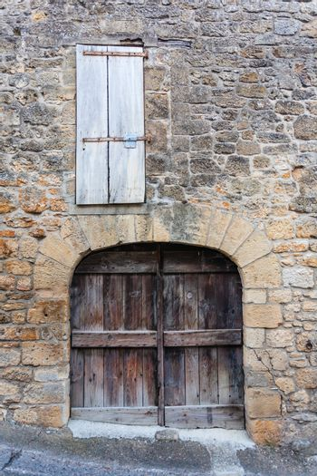 Closeup view of rural door and window in the french region of Dordogne