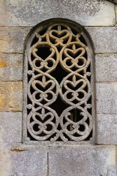 Stunning lattice window in the pre-romanesque church of San Salvador de Valdedios circa IX century in Asturias