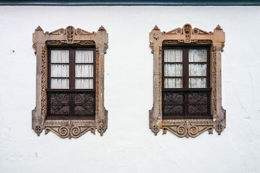 Two beautiful decorated windows in a wall of the Salina Palace in Salamanca Spain