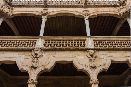 Beautiful stone archs and balcony delicate carving in the House of Shells in the city of Salamanca Spain