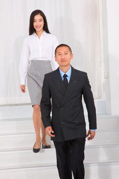 Businesspeople walking stairs