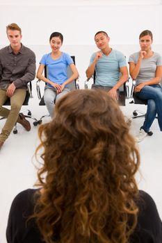 Executives sitting in seminar