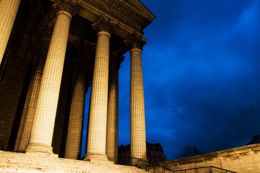 La madeleine church in Paris by night