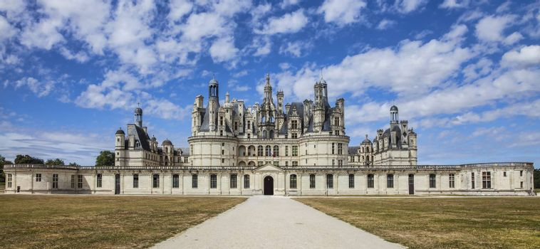 Image of the famous Chambord Castle located in the Loire Valley, in a beautiful summer day.