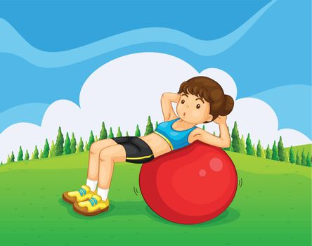 A young lady exercising with a bouncing ball in the hill