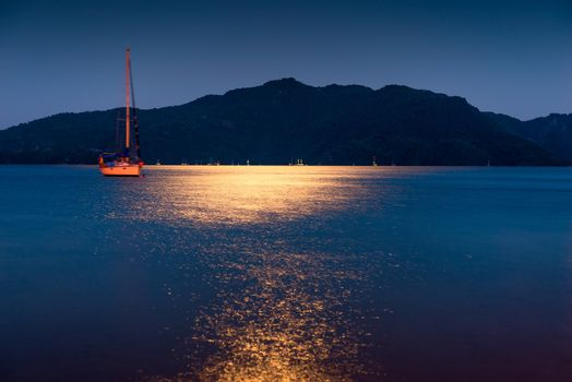 Beautiful evening seascape and drifting vessel