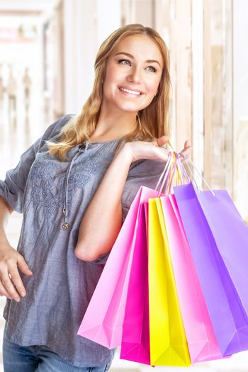 Cheerful girl with shopping bags
