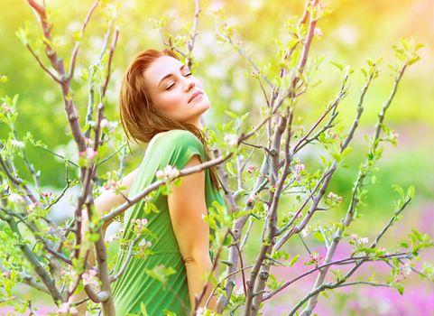Seductive woman in the garden