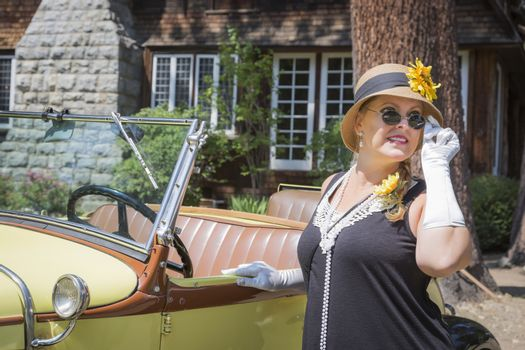 Attractive Woman in Twenties Outfit Near Antique Automobile