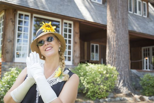 Attractive Woman in Twenties Outfit Near Antique House