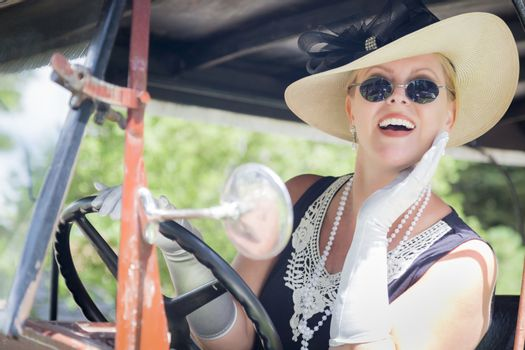 Attractive Woman in Twenties Outfit Driving an Antique Automobil