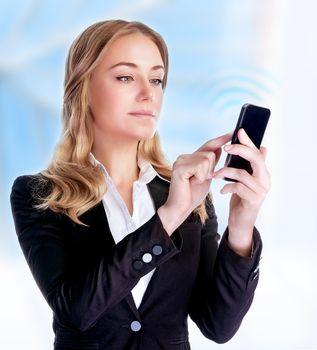 Businesswoman reading text message