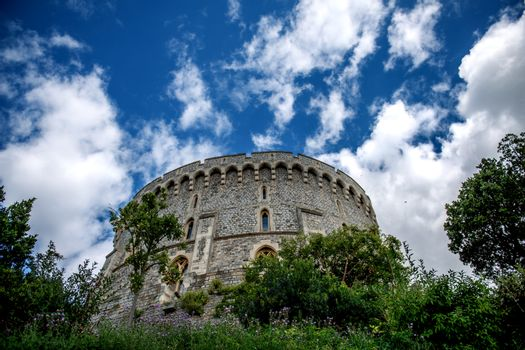 Windsor Castle is a royal residence at Windsor in the English county of Berkshire. It is notable for its long association with the English and British royal family and also for its architecture. The original castle was built in the 11th century after the invasion by William the Conqueror.   Since the time of Henry I, it has been used by succeeding monarchs and is the longest-occupied palace in Europe. The castle's lavish, early 19th century State Apartments are architecturally significant, and is described as a superb and unrivalled sequence of rooms widely regarded as the finest and most complete expression of later Georgian taste.  Photographed using Nikon-D800E (36 megapixels) DSLR with AF-S NIKKOR 24-70 mm f/2.8G ED lens at focal length 24 mm, ISO 100, and exposure 1/1600 sec at f/2.8.
