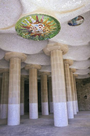 huge columns and mosaic ceiling in famous  Sala Hipostila in Park Guell, Barcelona which were designed by modernism architect Antoni Gaudi