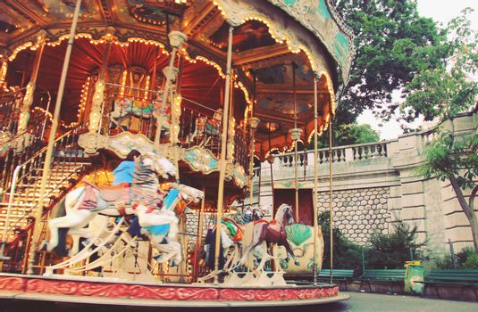 Carousel horse at the park with retro filter effect
