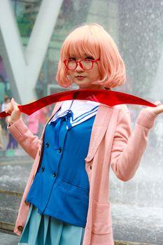 Bangkok - Aug 31: An unidentified Japanese anime cosplay Mirai Kuriyama pose  on August 31, 2014 at Central World, Bangkok, Thailand.