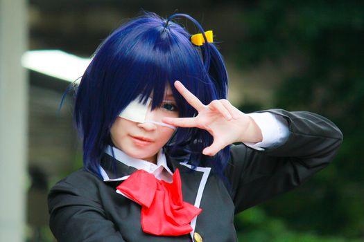 Bangkok - Aug 31: An unidentified Japanese anime cosplay Takanashi Rikka pose  on August 31, 2014 at Central World, Bangkok, Thailand.