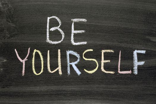 be yourself phrase handwritten on school blackboard