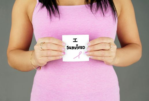 Woman survivor with paper