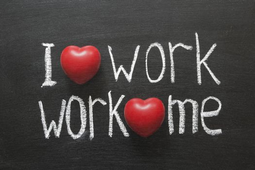 I love work, work loves me phrase handwritten on blackboard