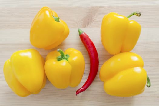 five sweet yellow paprika and one red hot chili pepper