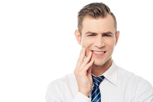 Male executive with toothache
