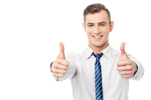 Smiling business executive with thumbs up