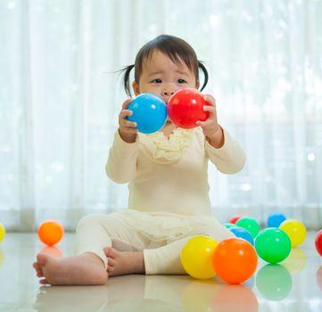 Portrait of little asian girl in home