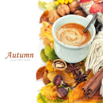 cozy cup of coffee and autumn leaves