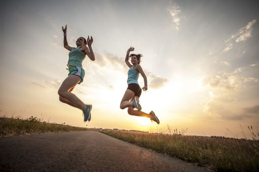 Two pretty girls jogging in the morning