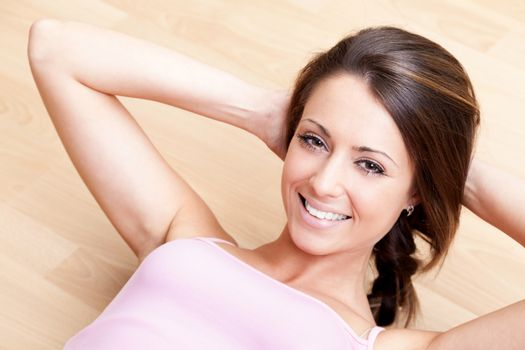 Smiling woman fitness abdominal exercises