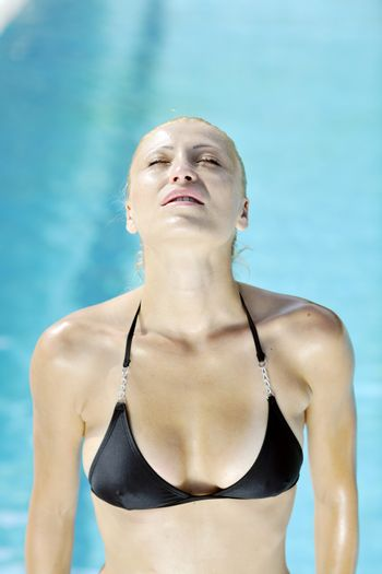 beautiful young woman relax and have fun at swimming pool