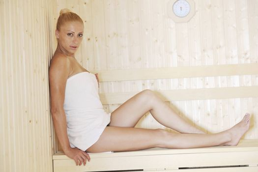beauty spa and wellnes body treatment with young woman at  wooden sauna