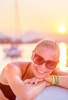 Cheerful girl in sea cruise