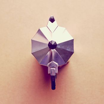 Top view of Italian coffee maker with retro filter effect