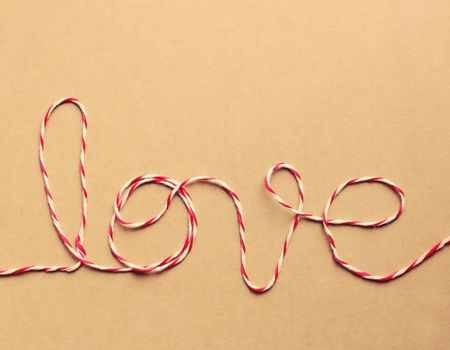 """The word """"love"""" written with rope, retro filter effect"""