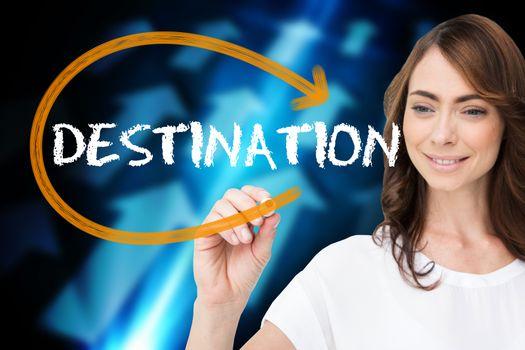Businesswoman writing the word destination