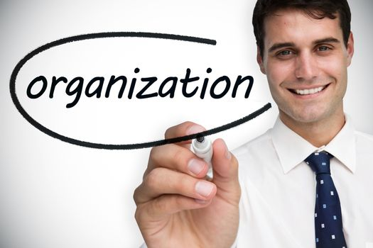 Businessman writing the word organization